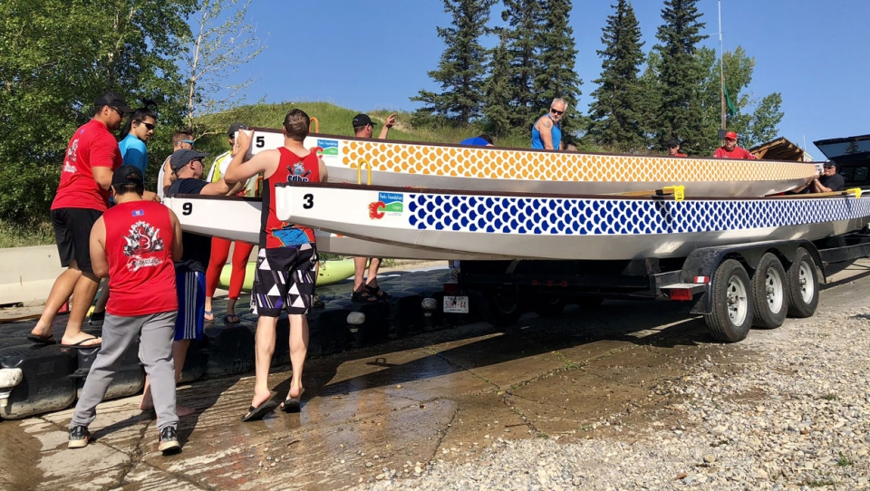 Unloading three of five new dragon boats that were paid for through a combination of city grants and fundraising.