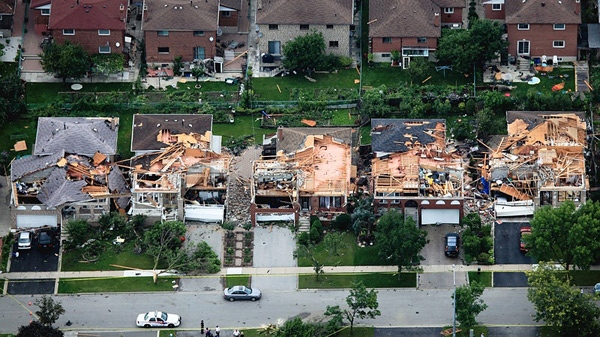 The damage from Thursday's storm is visible on the roofs of homes in Vaughan, Ont. on Friday, Aug. 21, 2009. (Tom Podolec / CTV News)