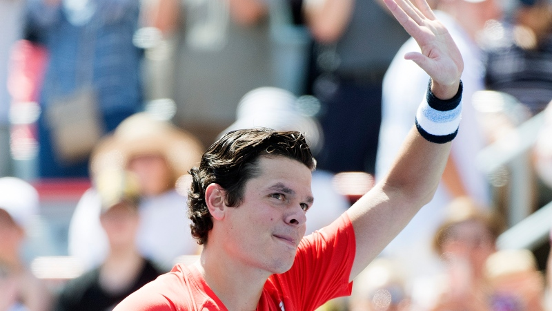 FILE - Milos Raonic of Canada waves to fans following his victory over Lucas Pouille of France during their first round match at the Rogers Cup tennis tournament in Montreal, Monday, August 5, 2019. THE CANADIAN PRESS/Graham Hughes
