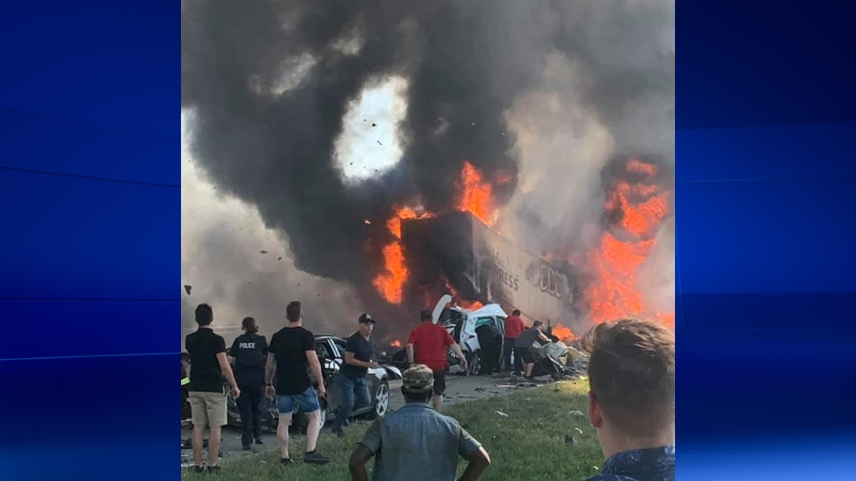 Witnesses help as two tractor-trailers and a passenger vehicle collided on Highway 440 in Laval on Aug. 5, 2019 (Photo courtesy Peter Christakos)