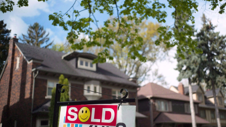 A sold sign is shown in front of west-end Toronto homes on May 14, 2017. THE CANADIAN PRESS/Graeme Roy