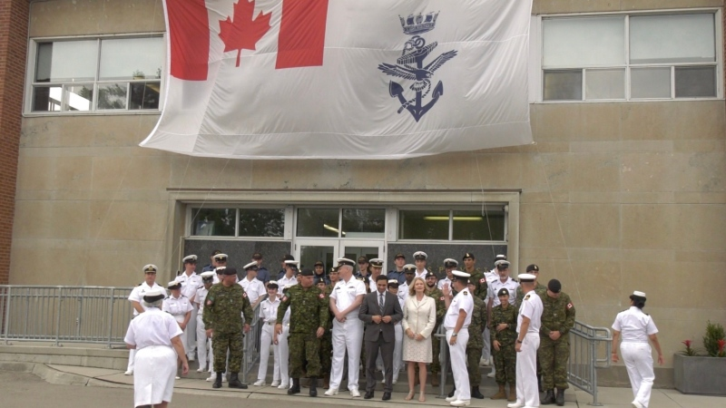 Officials gather outside the HMCS Prevost Naval Reserve in London, Ont. on Tuesday, Aug. 6, 2019. (Marek Sutherland / CTV London)