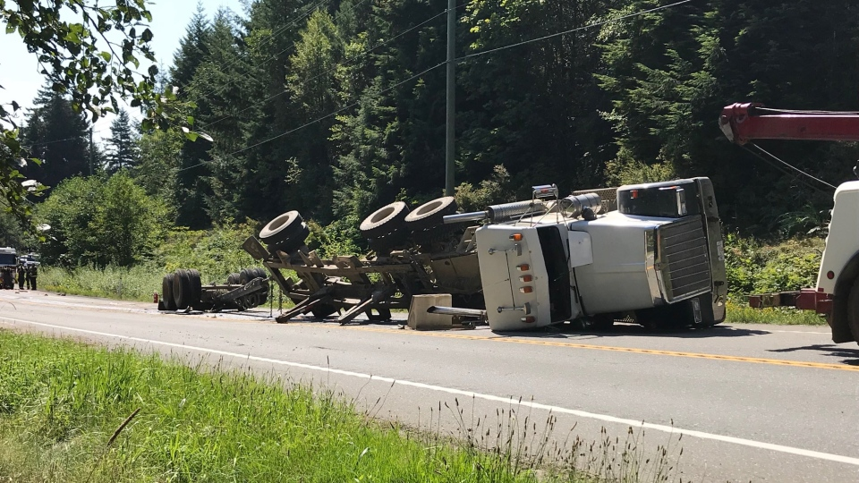 A logging truck overturned on Highway 19 north of Campbell River Tues., Aug. 6, 2019. (CTV Vancouver Island)