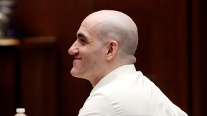 Michael Gargiulo smiles during a court appearance Tuesday, Aug. 6, 2019, in Los Angeles. Closing arguments started Tuesday in the trial of an air conditioning repairman charged with killing two Southern California women and attempting to kill a third. (Lucy Nicholson, Pool Photo via AP)
