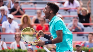 FILE - Felix Auger-Aliassime of Canada reacts in his match against compatriot Vasek Pospisil during the first round of play at the Rogers Cup tennis tournament, Tuesday, August 6, 2019 in Montreal. THE CANADIAN PRESS/Paul Chiasson