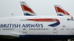 FILE - This Jan. 10, 2017 file photo shows British Airways planes parked at Heathrow Airport in London. (AP Photo/Frank Augstein, File)