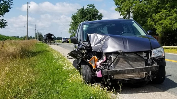 A damaged pickup and buggy are seen after a collision in Oxford County, Ont. on Wednesday, Aug. 7, 2019. (OPP West Region / Facebook)