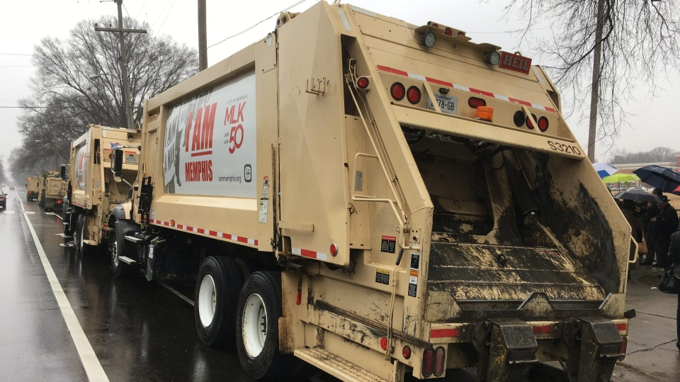 A garbage truck pays tribute to a campaign honoring a sanitation workers' strike that brought civil rights leader Martin Luther King Jr. to Memphis on Thursday, Feb. 1, 2018, in Memphis, Tenn. (AP Photo/Adrian Sainz)