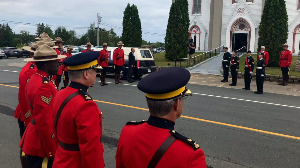 Mourners and members of the Honour Guard gather at the celebration of life for Lt.-Gov. Jocelyne Roy Vienneau in Robertville, N.B., on Aug. 8, 2019. (Laura Brown/CTV Atlantic)