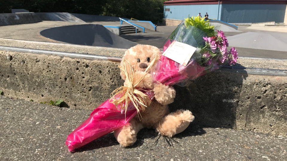 Flowers are seen at the Walnut Grove skate park in Langley Township, where officials are investigating the death of a teenager. Aug. 8, 2019.