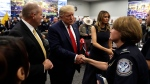 U.S. President Donald Trump and first lady Melania Trump speak to first responders as they visit the El Paso Regional Communications Center after meeting with people affected by the El Paso mass shooting, Wednesday, Aug. 7, 2019, in El Paso, Texas. (AP / Evan Vucci)