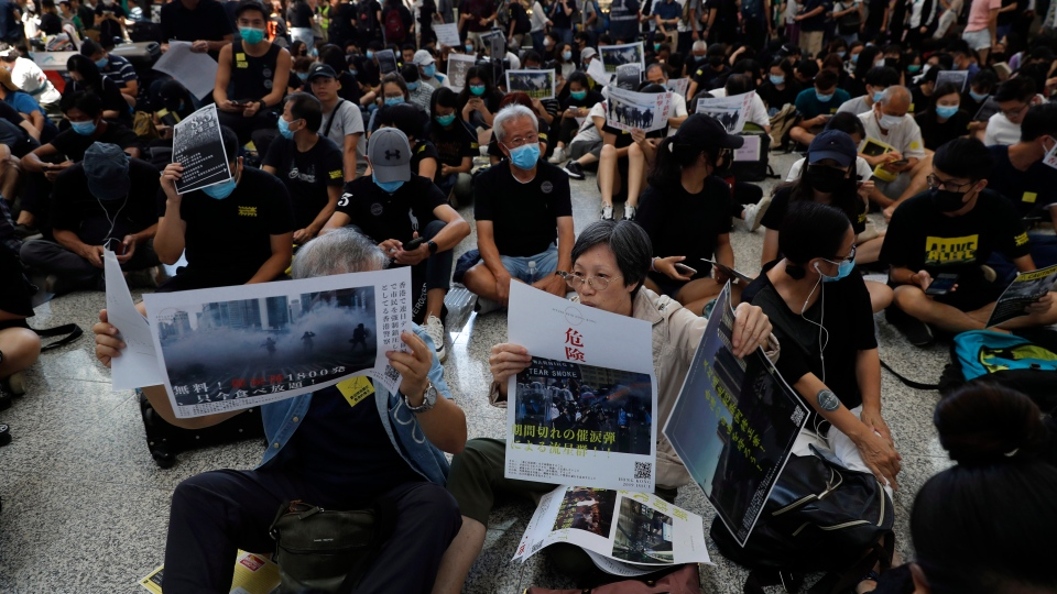 Protesters demonstrate at the airport in Hong Kong on Friday, Aug. 9, 2019.  (AP Photo/Vincent Thian)