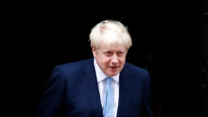 Britain's Prime Minister Boris Johnson leaves the door to welcome King Abdullah II of Jordan at 10 Downing Street in London, Wednesday, Aug. 7, 2019. (AP Photo/Frank Augstein)
