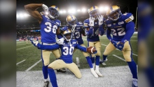 Winnipeg Blue Bombers' Mercy Maston (36), Winston Rose (30), Anthony Gaitor (23), Marcus Sayles (14) and Chandler Fenner (22) celebrate Rose's interception against the Calgary Stampeders during the last seconds of the second half of CFL action in Winnipeg Thursday, August 8, 2019. (Source:The Canadian Press/John Woods)