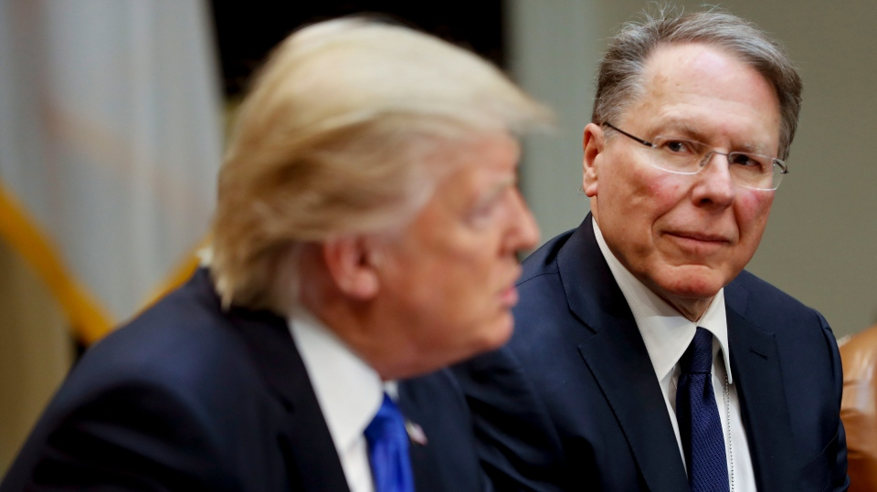 In a Feb. 1, 2017, file photo, National Rifle Associations (NRA) Executive Vice President and Chief Executive Officer Wayne LaPierre listens at right as U.S. President Donald Trump speaks in the Roosevelt Room of the White House in Washington. (AP Photo/Pablo Martinez Monsivais)