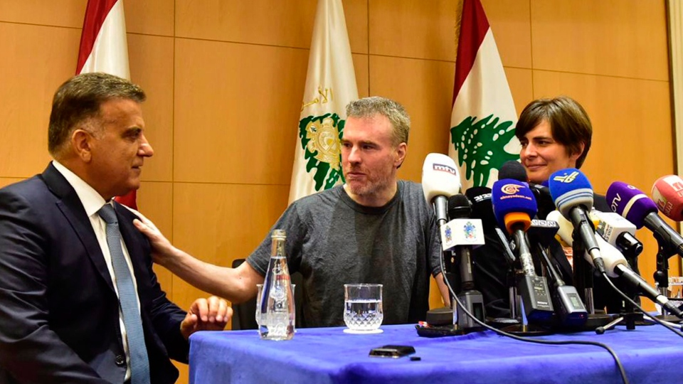 Lebanon's General Security Chief Maj. Gen. Abbas Ibrahim, left, speaks with Kristian Lee Baxter, centre, of Nanaimo, B.C., during a press conference in Beirut, Lebanon, Friday, Aug 9, 2019. (The Lebanese General Security Directorate)