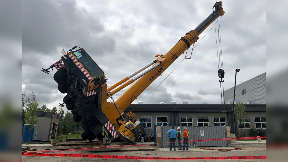 A crane tipped over outside of Dr. Margaret Ann Armour School. (Cam Wiebe/CTV News Edmonton)