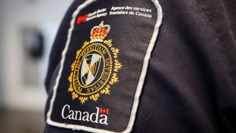 A Canada Border Services Agency (CBSA) patch is seen on an officer in Calgary, Alta., Thursday, Aug. 1, 2019. (THE CANADIAN PRESS/Jeff McIntosh)