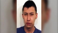 Malik Holloway, 21, was arrested by Cochrane RCMP on August 16, 2019.