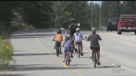 CHILDREN AND PARENTS RIDING BIKES
