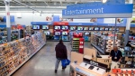 In this Dec. 15, 2010 file photo, a view of the entertainment section of a Wal-Mart store is seen in Alexandria, Va. (AP Photo, File)