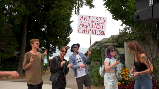 """Protesters gathered outside billionaire Lululemon founder Chip Wilson's mansion in West Point Grey Saturday for what they called a """"rave against renovictions."""" (CTV)"""