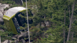 A Sea to Sky gondola lies on its side in the forest. The company that operates them in Squamish, B.C., said Monday that the damage could be millions of dollars.