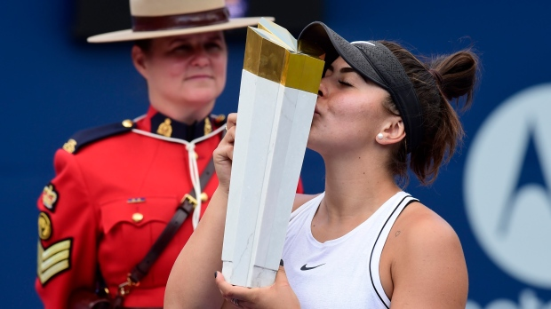 Winner Bianca Andreescu of Canada kisses the winner's trophy after winning the final of the Rogers Cup tennis tournament in Toronto on Sunday, Aug. 11, 2019. THE CANADIAN PRESS/Frank Gunn
