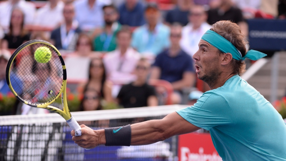 Spain's Rafael Nadal hits a shot to Russia's Daniil Medvedev during the final of the Rogers Cup tennis tournament in Montreal, Sunday, August 11, 2019. THE CANADIAN PRESS/Paul Chiasson