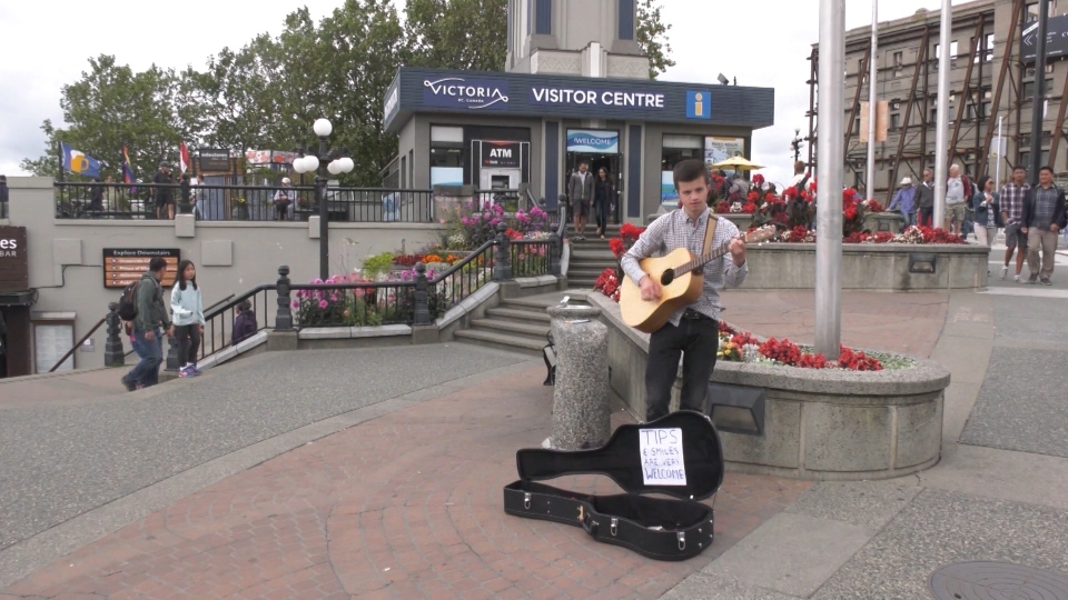 Fernando Garci-Crespo Santalo, 20, says he was busking and singing a song in Spanish when the man claimed he was an off-duty immigration worker and demanded to see his documentation and his busking licence. (CTV Vancouver Island)