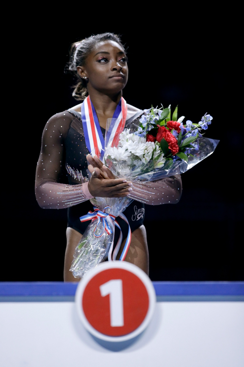 Simone Biles waits to be announced as the all-around winner after the senior women's competition at the 2019 U.S. Gymnastics Championships Sunday, Aug. 11, 2019, in Kansas City, Mo. (AP Photo/Charlie Riedel)