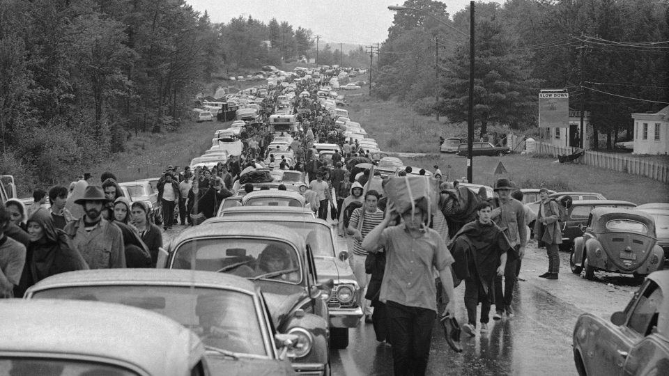 FILE - In this Aug. 16, 1969 file photo, hundreds of rock music fans jam a highway leading from Bethel, N.Y., as they try to leave the Woodstock Music and Art Festival. (AP Photo, File)