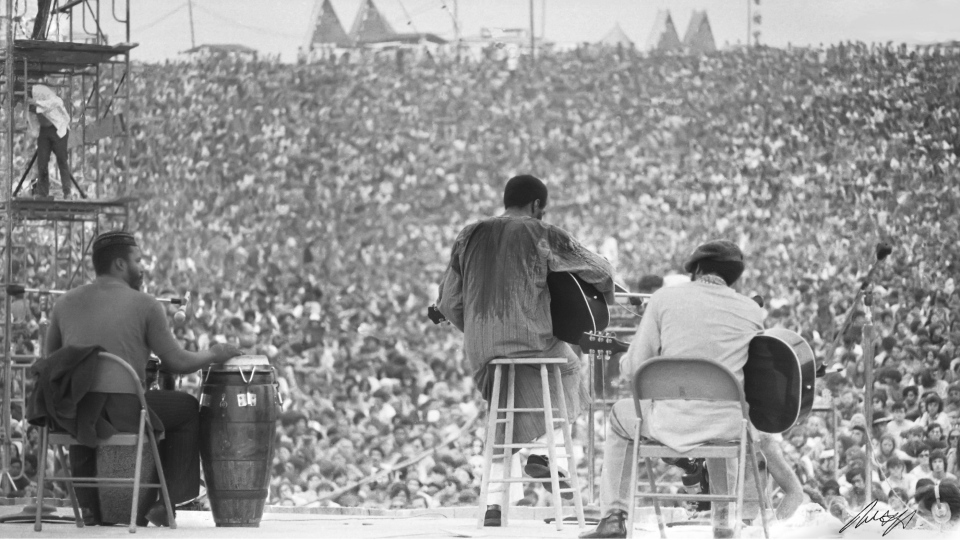 This August, 1969 photo shows Richie Havens as he performs during Woodstock in Bethel, N.Y. (Mark Goff Photography, Leah Demarco/Allison Goff via AP)