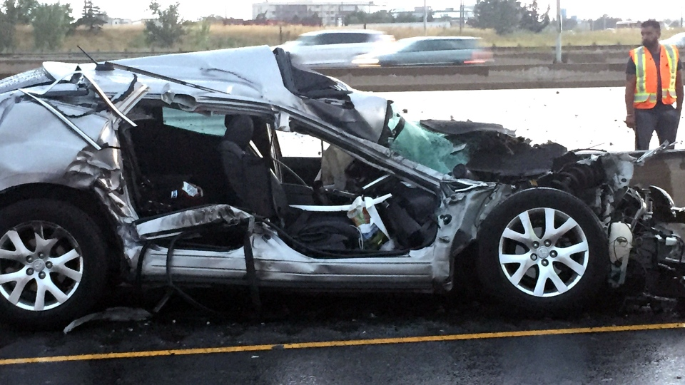 The wreckage of a fatal three-vehicle collision in the eastbound lanes of Highway 401 near Dixie Road road are pictured a day later. (Arda Zakarian /CP24)