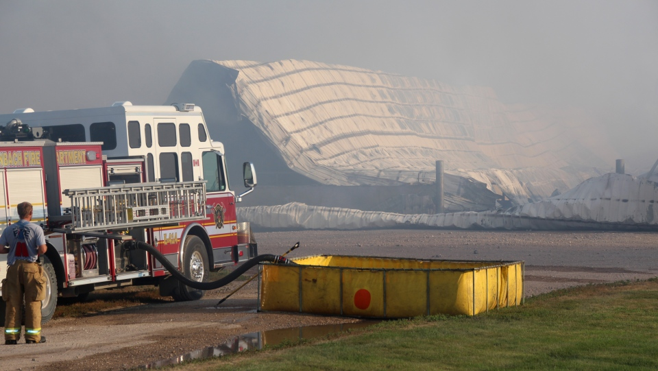 The aftermath of a dairy farm fire is shown northeast of Steinbach, Man. on Monday, Aug.12, 2019 in a handout photo. (THE CANADIAN PRESS/Steinbachonline)