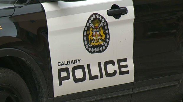 Calgary police arrested two men wanted on warrants after an off-duty officer found himself in the right place at the right time.
