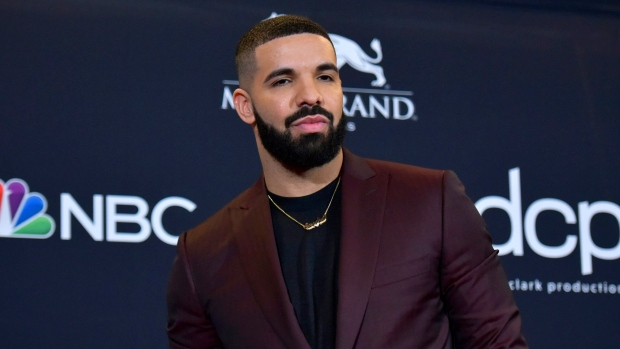 Drake gets Beatles tattoo after beating their top 10 record