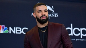 This May 1, 2019 file photo shows Drake at the Billboard Music Awards in Las Vegas.  THE CANADIAN PRESS/AP-Photo by Richard Shotwell/Invision/AP, File