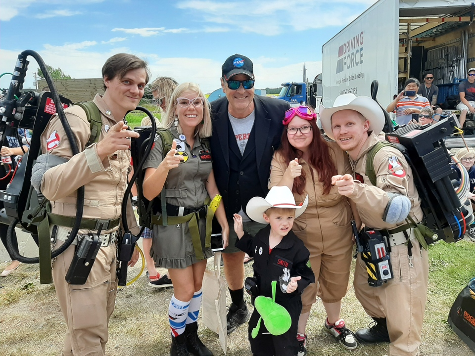 Original Ghostbusters cast member Dan Akroyd (centre, in ballcap) meets with a group of Calgary fans on the set of the latest instalment in the Ghostbusters saga in Crossfield, Alta.