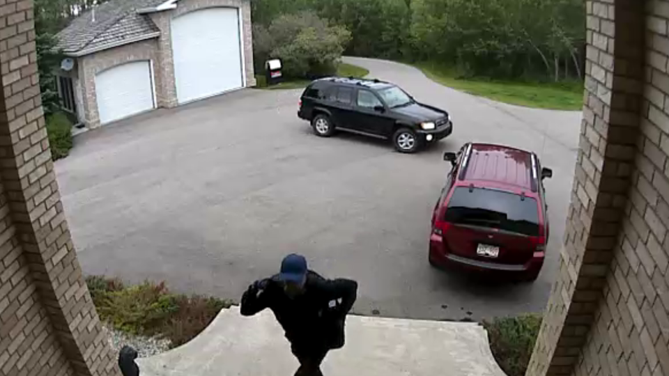 A surveillance camera captured the suspect in the attempted break-in as well as two suspect vehicles; a Mitsubishi Endeavour and a Nissan Pathfinder (RCMP)