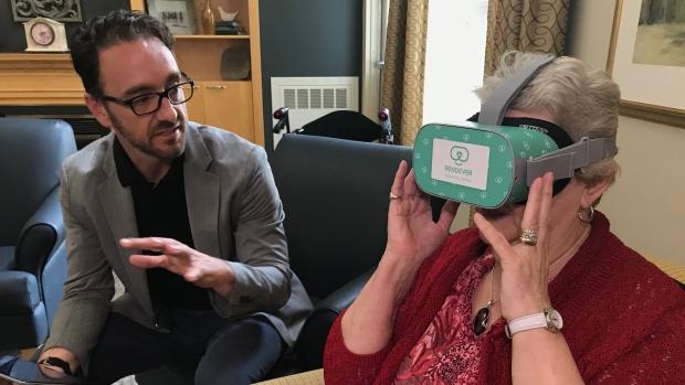 A woman using a virtual reality headset
