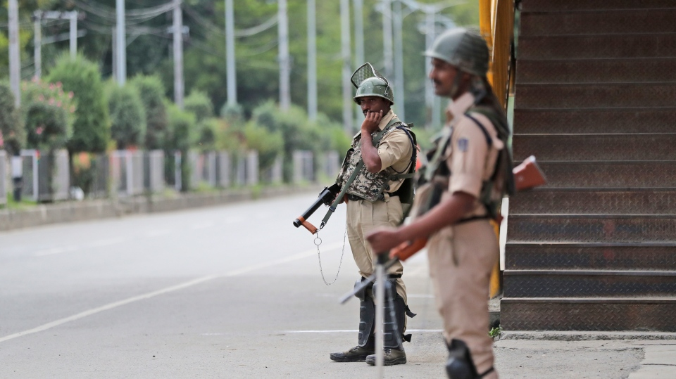 Indian paramilitary soldiers stand guard during a security lockdown in Srinagar, Indian controlled Kashmir, Monday, Aug. 12, 2019. (AP Photo/Mukhtar Khan)