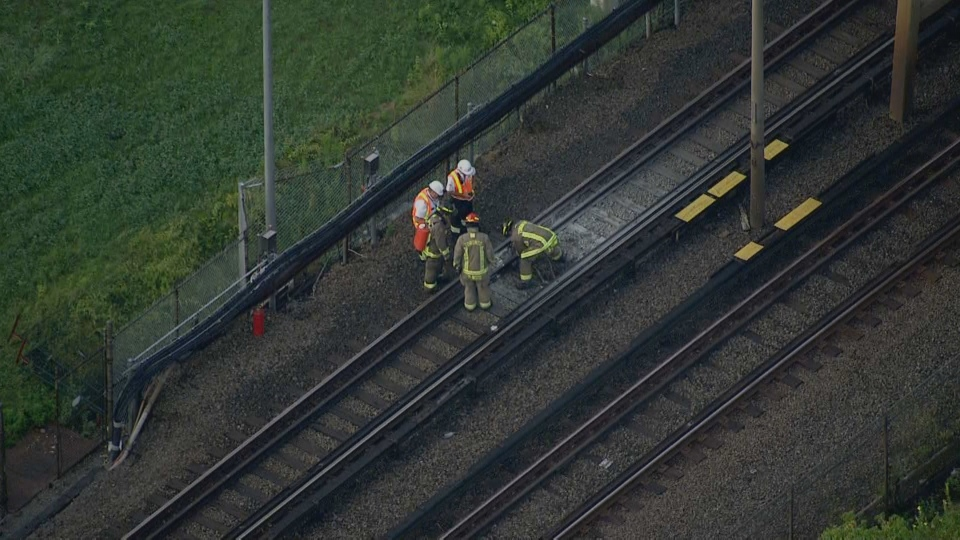 Authorities are seen near Victoria Park Station after a fire broke out on August 13. (CTV News Toronto)