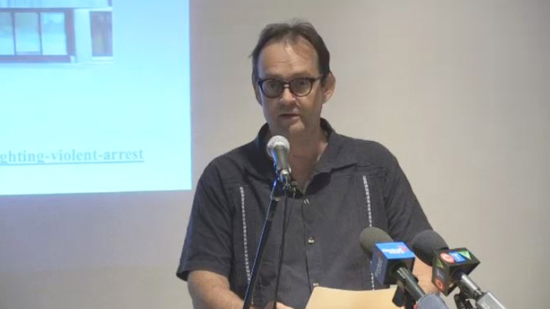 John Perkins, a member of Sustainable Northern Nova Scotia, announces he is launching a lawsuit in connection with his arrest at a public meeting in May to discuss gold mining near Sherbrooke, N.S., August 13, 2019.