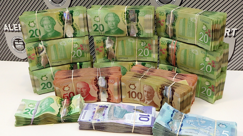 Cash seized from two Edmonton homes.