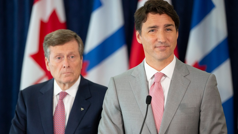 Prime Minister Justin Trudeau (right) stands alongside Toronto Mayor John Tory as he takes questions from journalists following their meeting at Toronto City Hall, on Tuesday August 13, 2019. THE CANADIAN PRESS/Chris Young