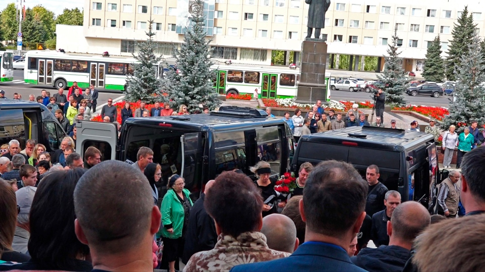 People gather for the funerals of five Russian nuclear engineers killed by a rocket explosion in Sarov, the closed city, located 370 kilometers east of Moscow, Monday, Aug. 12, 2019. (Russian State Atomic Energy Corporation ROSATOM via AP)