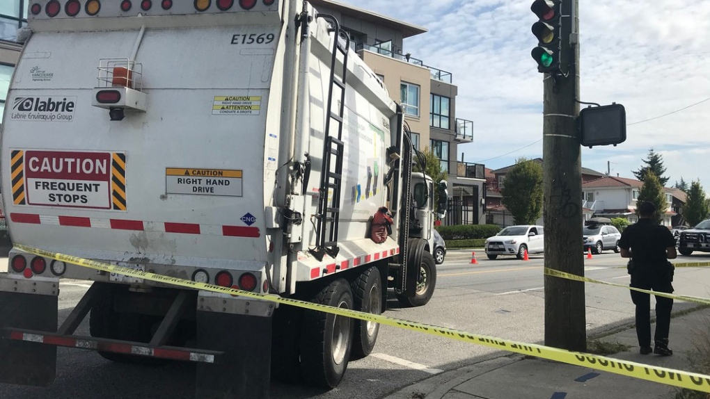 pedestrian hit by garbage truck main and 33rd