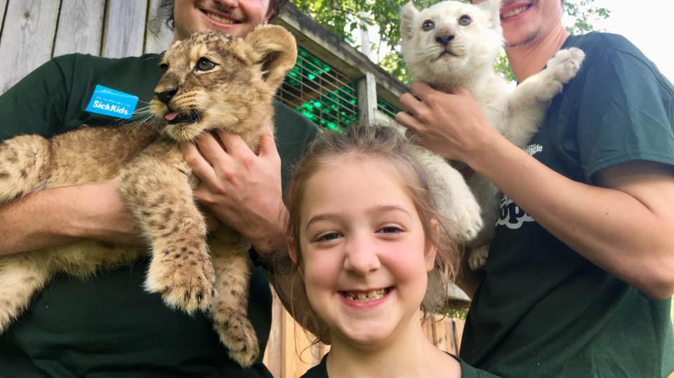 Mila Kasper, 7, visits the Elmvale Jungle Zoo on Mila's Day on Tues., Aug. 13, 2019. (KC Colby/CTV News)