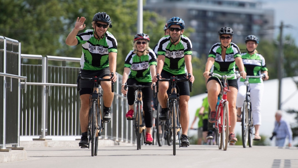 Zac Wagman, left, and his brother Nick ride ride with Minister of Environment and Climate Change Catherine McKenna, Project Learning Tree Canada CEO Kathy Abusow, second from right, and Liberal MP Mona Fortier, right, before a press conference promoting their Green Ride for Green Jobs, in Ottawa on Monday, Aug. 12, 2019.THE CANADIAN PRESS/Justin Tang